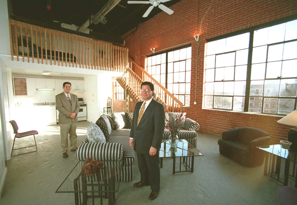 Photo -  Developers Mark Ruffin, left, and Nick Preftakes, Precor Realty Advisors Inc. stand in a loft apartment complex believed to be the first in the city which opened at 113 NW 13 in a former auto dealership garage.