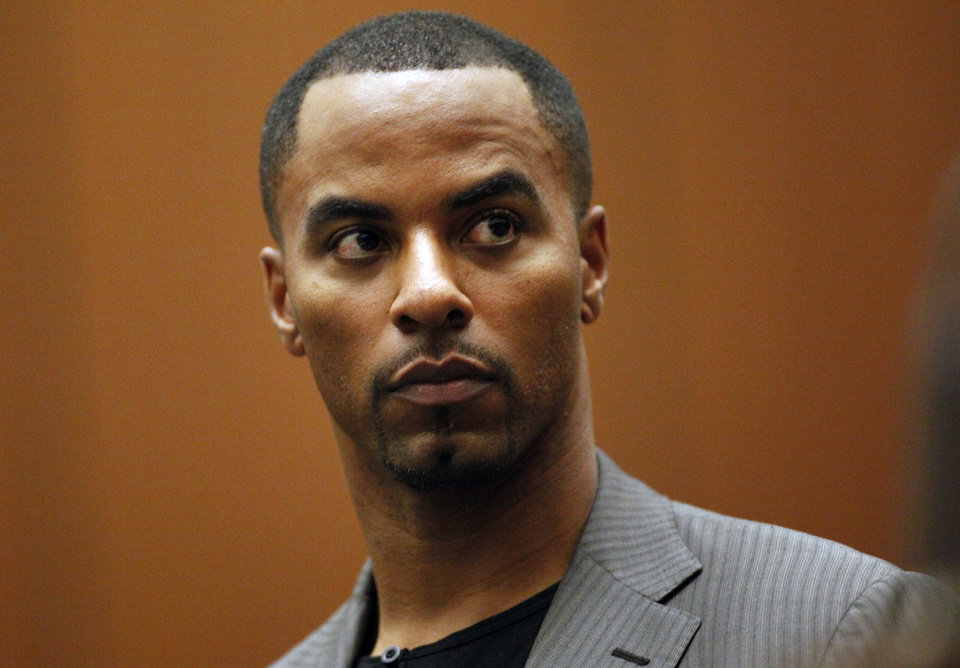 Photo - Former NFL safety Darren Sharper appears in Los Angeles Superior Court on Thursday, Feb. 20, 2014, in Los Angeles. Sharper has pleaded not guilty to charges that he drugged and raped two women he met at a West Hollywood night club. (AP Photo/Los Angeles Times, Bob Chamberlin, Pool)