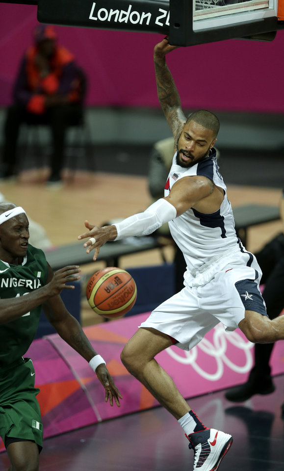 Photo -   United States' Tyson Chandler, right, tries to block a pass by Nigeria's Ejike Ugboaja during a men's basketball game at the 2012 Summer Olympics, Thursday, Aug. 2, 2012, in London. (AP Photo/Charlie Riedel)