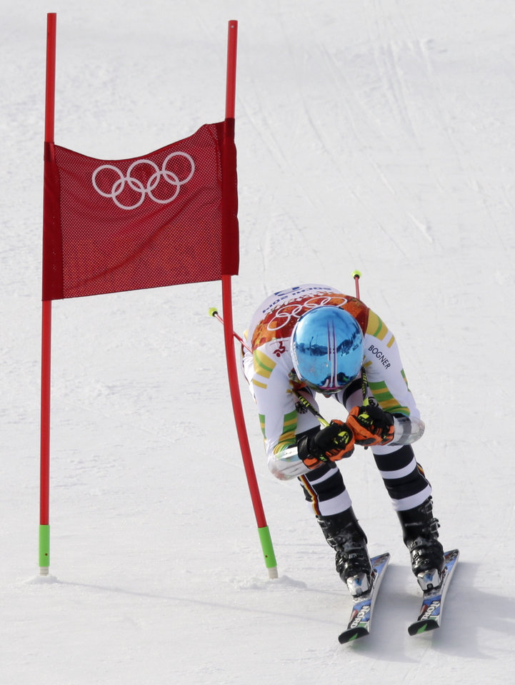 Photo - Germany's Felix Neureuther passes a gate in the first run of the men's giant slalom at the Sochi 2014 Winter Olympics, Wednesday, Feb. 19, 2014, in Krasnaya Polyana, Russia. (AP Photo/Gero Breloer)