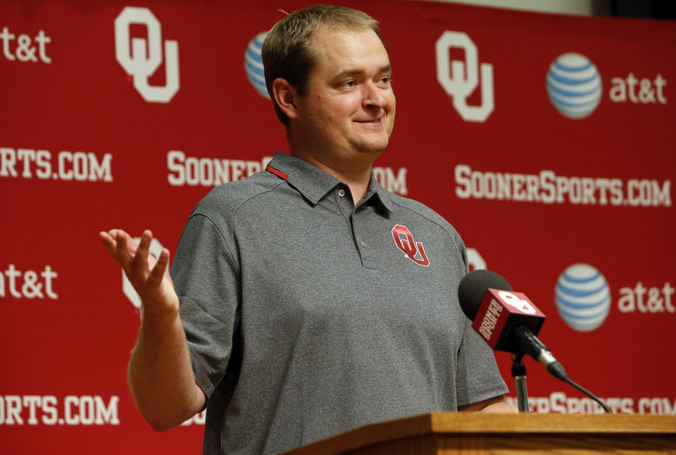 Photo - Co-Offensive coordinator Josh Heupel addresses the media during media access day for the University of Oklahoma Sooner (OU) football team in the Adrian Peterson meeting room inside Gaylord Family-Oklahoma Memorial Stadium in Norman, Okla., on Saturday, Aug. 3, 2013. Photo by Steve Sisney, The Oklahoman