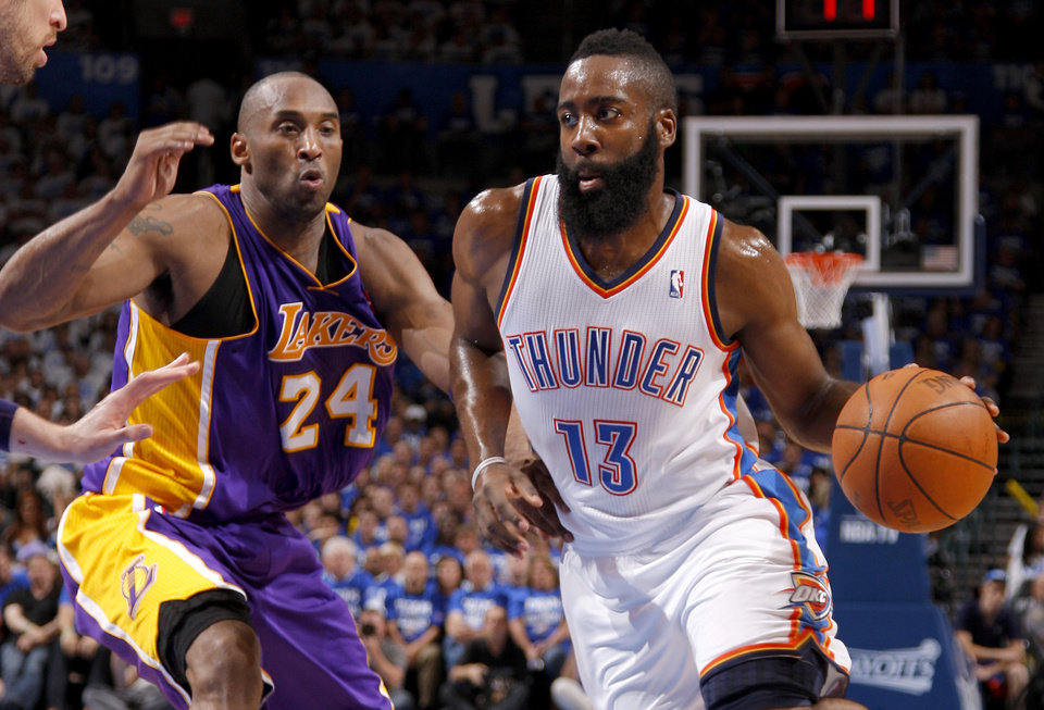Photo - Oklahoma City's James Harden (13) drives past Los Angeles' Kobe Bryant (24) during Game 2 in the second round of the NBA playoffs between the Oklahoma City Thunder and L.A. Lakers at Chesapeake Energy Arena in Oklahoma City, Wednesday, May 16, 2012.  Oklahoma City won 77-75. Photo by Bryan Terry, The Oklahoman