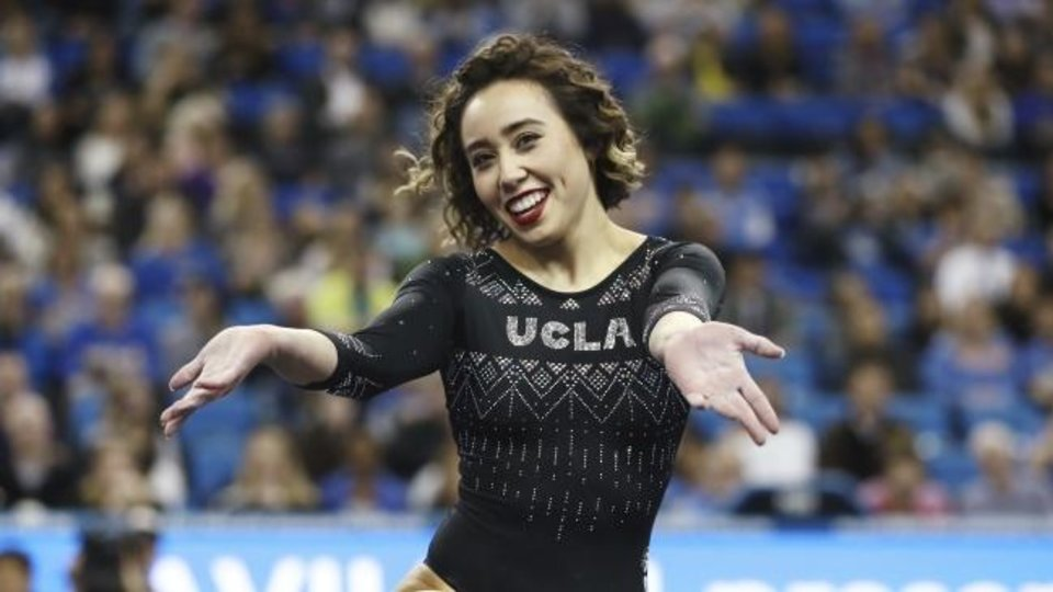 Photo -  Katelyn Ohashi's floor routine has been viewed more than 34 million times. The UCLA gymnast is using the attention from her viral video to bring attention to the problem of body image shaming. [AP PHOTO]