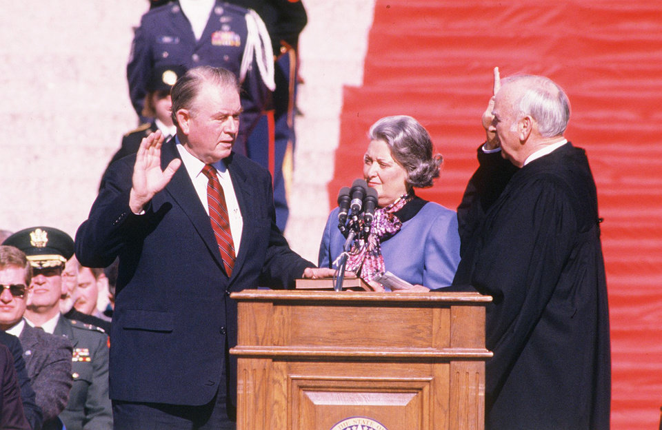 As his wife, Shirley, looks on, Henry Bellmon is sworn in as governor in 1987. OKLAHOMAN ARCHIVE PHOTO