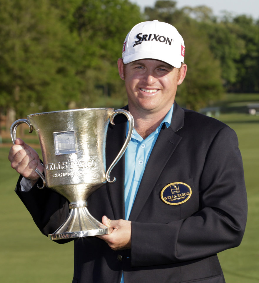 Photo - J.B. Holmes poses with the trophy after winning the Wells Fargo Championship golf tournament in Charlotte, N.C., Sunday, May 4, 2014. (AP Photo/Bob Leverone)