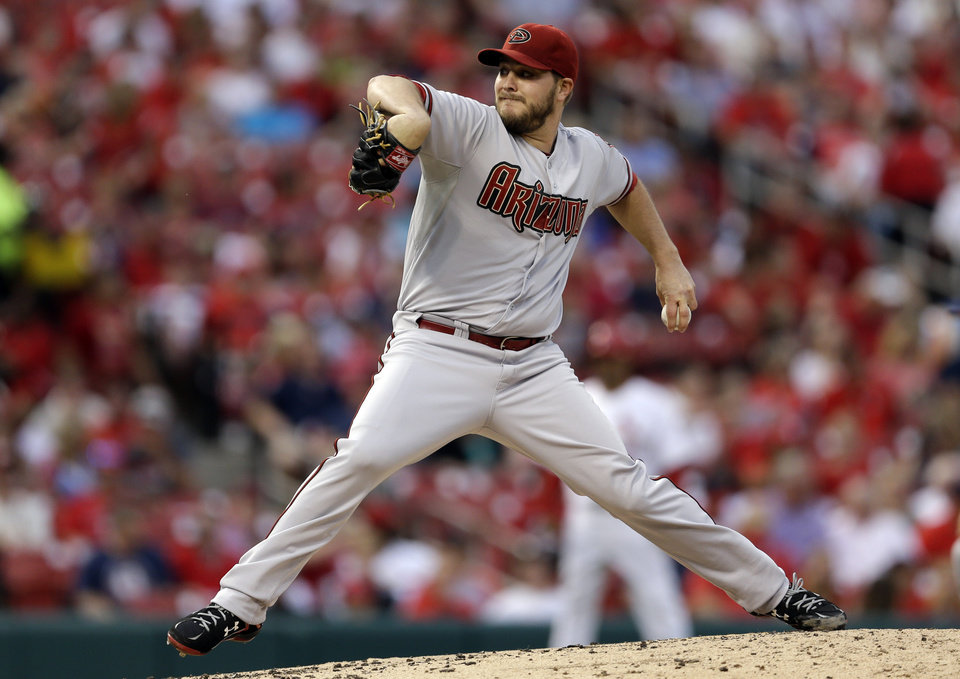 Photo - Arizona Diamondbacks starting pitcher Wade Miley throws during the first inning of a baseball game against the St. Louis Cardinals Thursday, May 22, 2014, in St. Louis. (AP Photo/Jeff Roberson)