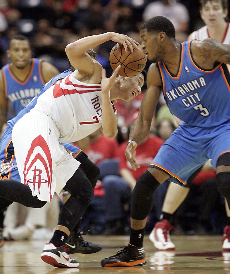 Houston Rockets' Jeremy Lin tries to control ball away from Oklahoma City Thunder defender Perry Jones during the second quarter of an NBA preseason basketball game in Hidalgo, Texas, Wednesday, Oct. 10, 2012. (AP Photo/Delcia Lopez) ORG XMIT: TXDL109