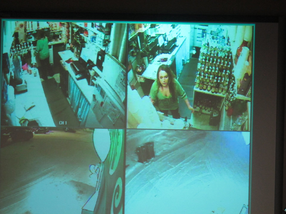 Photo - During a news conference, police show surveillance video of  Samantha Koenig, 18, making a cup of Americano coffee for a customer who shortly after abducted her Feb. 1, 2012, in Anchorage, Alaska. Police on Tuesday, Dec. 4, 2012, released the surveillance camera footage from the February abduction at the Common Grounds expresso stand in Anchorage. The release came two days after her confessed killer, Israel Keyes, was found dead in his Anchorage jail cell, apparently by suicide. (AP Photo/Mark Thiessen)