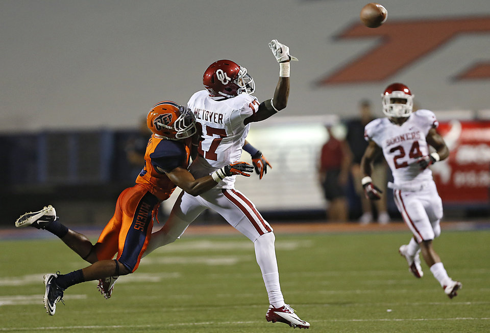 Photo - Oklahoma Sooners wide receiver Trey Metoyer (17) misses the pass while defended on by UTEP's Drew Thomas (10) during the college football game between the University of Oklahoma Sooners (OU) and the University of Texas El Paso Miners (UTEP) at Sun Bowl Stadium on Saturday, Sept. 1, 2012, in El Paso, Tex.  Photo by Chris Landsberger, The Oklahoman