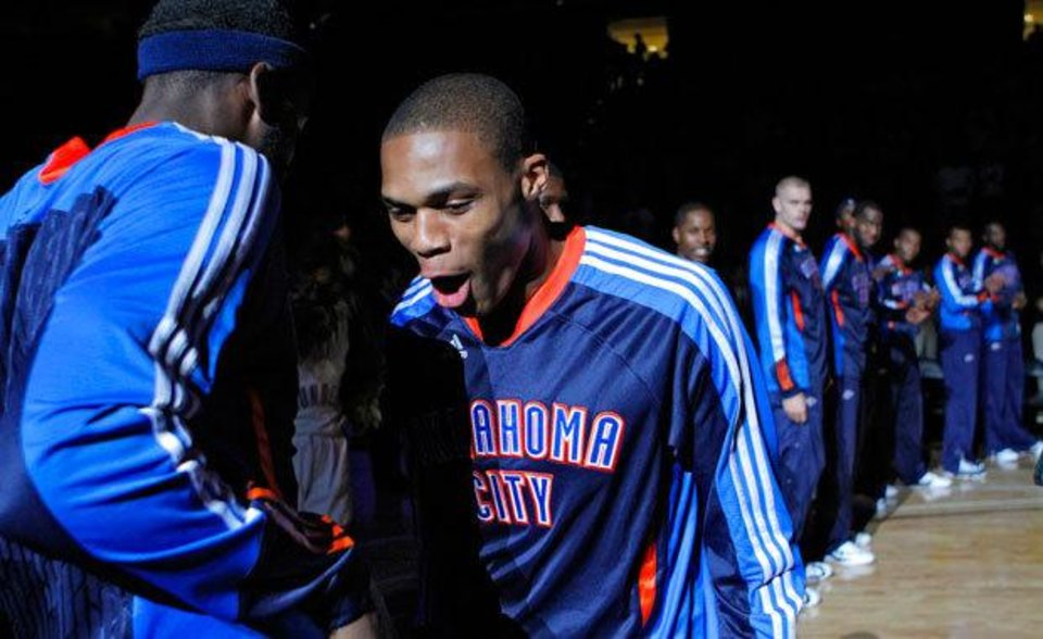 Photo - OKC's Russell Westbrook makes his way to the court during team introductions before the start of the preseason NBA basketball game between the Oklahoma City Thunder and the Memphis Grizzlies on Tuesday, Oct. 12, 2010, in Tulsa, Okla.  Photo by Chris Landsberger, The Oklahoman