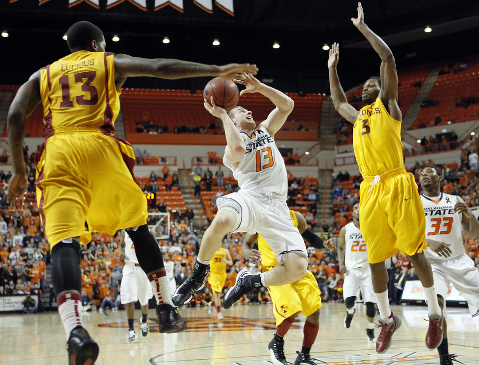 Photo - Oklahoma State's Phil Forte (13) shoots over Iowa State Cyclones' Korie Lucious (13) and Melvin Ejim (3) during the college basketball game between the Oklahoma State University Cowboys (OSU) and the Iowa State University Cyclones (ISU) at Gallagher-Iba Arena on Wednesday, Jan. 30, 2013, in Stillwater, Okla.  Photo by Chris Landsberger, The Oklahoman