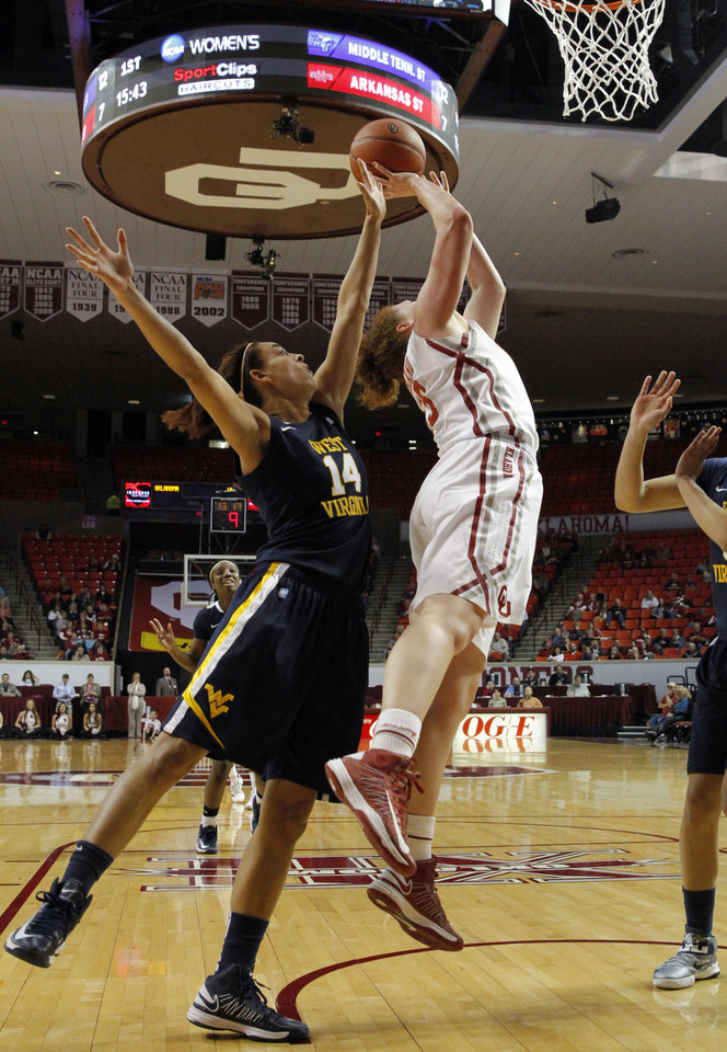 Oklahoma Sooner's Joanna McFarland (53) shoots guarded by West Virginia Mountaineers' Jess Harlee (14) as the University of Oklahoma Sooners (OU) play the West Virginia Mountaineers in NCAA, women's college basketball at The Lloyd Noble Center on Wednesday, Jan. 2, 2013  in Norman, Okla. Photo by Steve Sisney, The Oklahoman