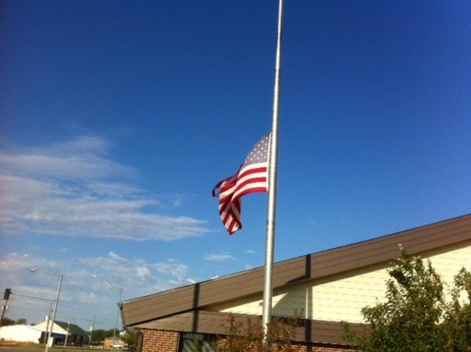 Photo - Flag at half-staff at Mustang Fire Department. Photo by Robert Medley