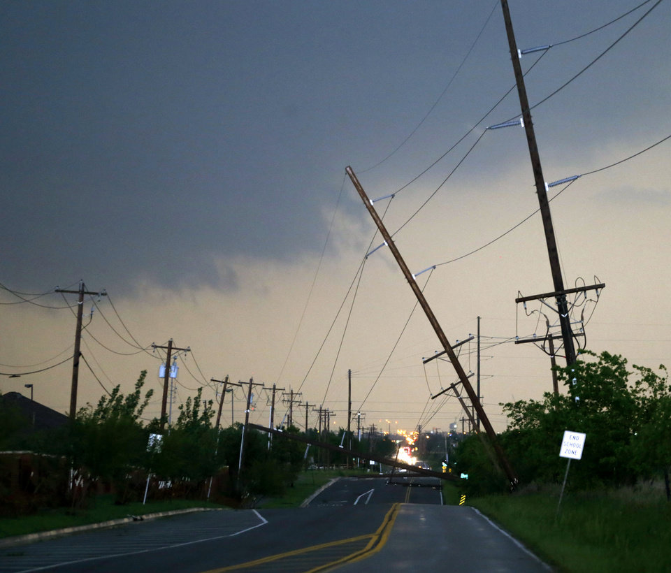 Photo - Utility lines block 36th Ave. in Norman after storms moved through the area on Wednesday, May 6, 2015. Photo by Bryan Terry, The Oklahoman