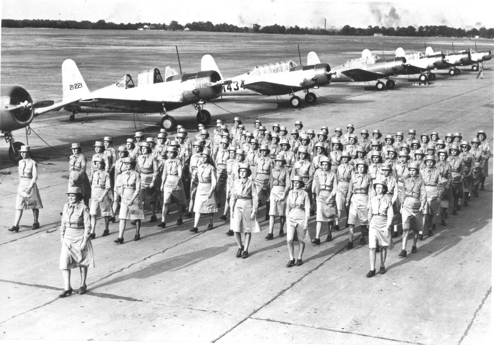 Photo -  Air WACs parade past a line of BT-13s in 1944. [Photo provided by Tinker History Office]
