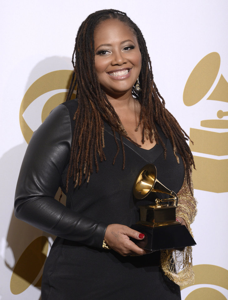 """Photo - Lalah Hathaway poses in the press room with the award for best R&B performance for """"Something"""" at the 56th annual GRAMMY Awards at Staples Center on Sunday, Jan. 26, 2014, in Los Angeles. (Photo by Dan Steinberg/Invision/AP)"""