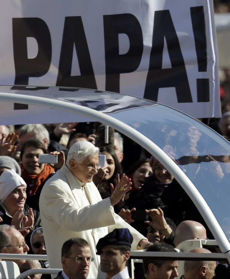 "Pope Benedict XVI waves as he arrives for  his last general audience in St. Peter's Square at the Vatican, Wednesday, Feb. 27, 2013. Tens of thousands of people toting banners saying ""Thank you!"" jammed St. Peter's Square on Wednesday to bid farewell to Pope Benedict XVI at his final general audience, the appointment he kept each week to teach the world about the Catholic faith. (AP Photo/Gregorio Borgia)"