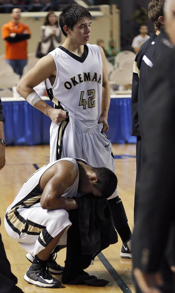 Photo - Okemah's Dion Scott (42) and Stoney Newton (33) react to the loss against Millwood during the state high school basketball tournament Class 3A boys championship game between Millwood High School and Okemah High School at the State Fair Arena on Saturday, March 9, 2013, in Oklahoma City, Okla. Photo by Chris Landsberger, The Oklahoman