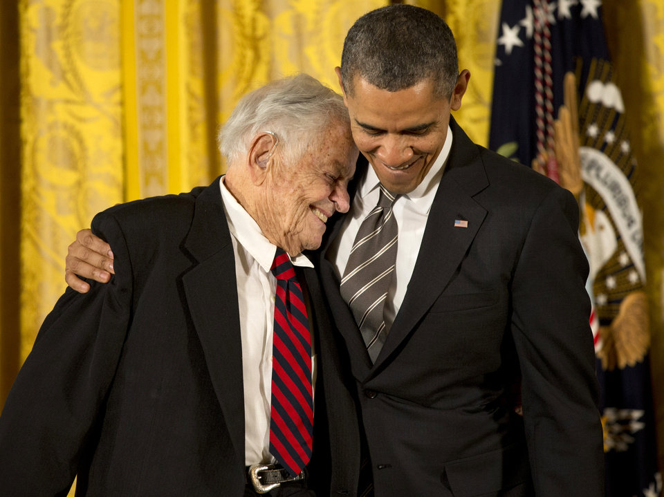President Barack Obama hugs Dr. T. Berry Brazelton, of Boston, Mass., one of the foremost authorities on pediatrics and child development, as he presents him with a 2012 Citizens Medal, Friday, Feb. 15, 2013, during a ceremony in the East Room of the White House in Washington.   (AP Photo/Jacquelyn Martin)