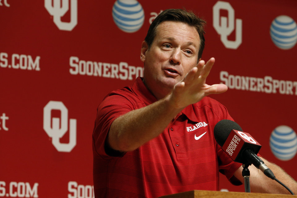 Photo - Head coach Bob Stoops addresses the media during media access day for the University of Oklahoma Sooner (OU) football team in the Adrian Peterson meeting room inside Gaylord Family-Oklahoma Memorial Stadium in Norman, Okla., on Saturday, Aug. 3, 2013. Photo by Steve Sisney, The Oklahoman