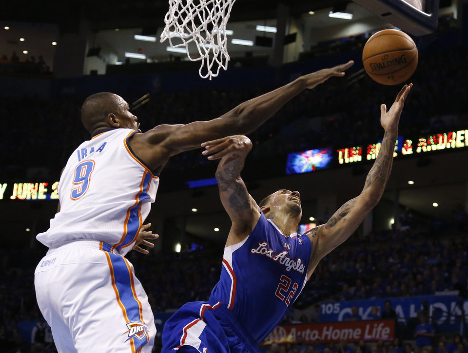Photo - Oklahoma City Thunder forward Serge Ibaka (9) blocks a shot by Los Angeles Clippers forward Matt Barnes (22) in the first quarter of Game 1 of the Western Conference semifinal NBA basketball playoff series in Oklahoma City, Monday, May 5, 2014. (AP Photo/Sue Ogrocki)