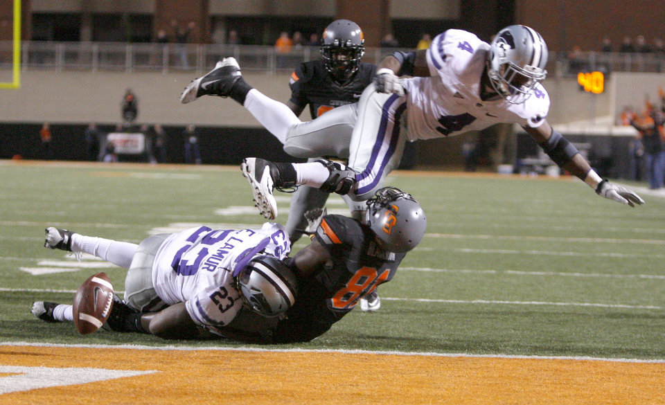 Photo - Oklahoma State's Justin Blackmon (81) fumbles the ball as Kansas State's Emmanuel Lamur (23) and Arthur Brown (4) tackle him during a college football game between the Oklahoma State University Cowboys (OSU) and the Kansas State University Wildcats (KSU) at Boone Pickens Stadium in Stillwater, Okla., Saturday, Nov. 5, 2011.  Photo by Sarah Phipps, The Oklahoman