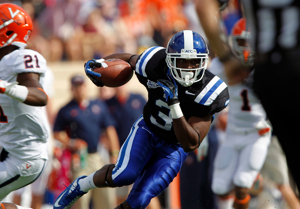 Photo -   Duke wide receiver Jamison Crowder (3) runs for a touchdown past Virginia safety Brandon Phelps (21) during the first quarter of an ACC college football game in Durham N.C., on Saturday, Oct. 6, 2012. (AP Photo/The News & Observer, Chris Seward)