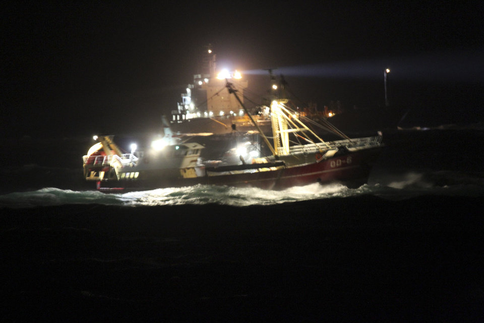 In this photograph released by the Royal Dutch Navy ships taking part in the rescue operation for sunken cargo ship Baltic Ace are seen in high waves late Wednesday night, Dec. 5, 2012. Four crew members died and seven were missing in the icy waters of the North Sea, after a cargo ship collided with another vessel and sank off the Dutch coast Wednesday night, rescuers said. The 148-meter (485-foot) Baltic Ace collided with the 134-meter (440-foot) container ship Corvus J in darkness near busy shipping lanes some 65 kilometers (40 miles) off the coast of the southern Netherlands. The Baltic Ace, carrying a cargo of cars, had a crew of 24 which was forced to abandon ship as it sank quickly. (AP Photo/Royal Dutch Navy) NO SALES MANDATORY CREDIT