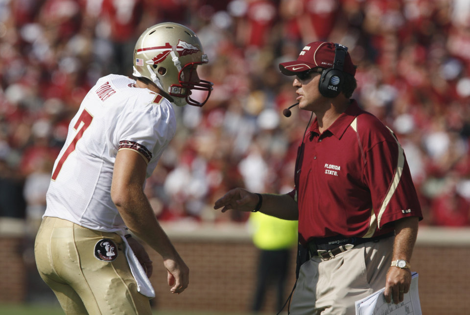 Christian Ponder (12) and head coach Jimbo Fisher talk during the first half of the college football game between the University of Oklahoma Sooners (OU) and Florida State University Seminoles (FSU) at the Gaylord Family-Oklahoma Memorial Stadium on Saturday, Sept. 11 2010, in Norman, Okla. Photo by Steve Sisney, The Oklahoman