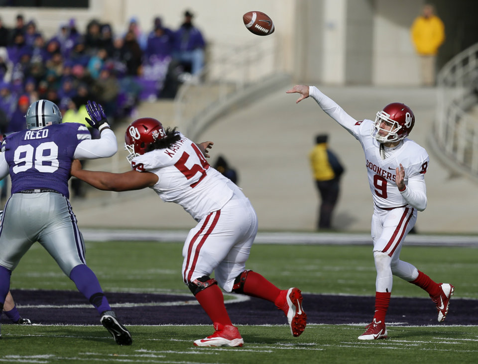 Oklahoma\'s Trevor Knight (9) throws a pass during an NCAA college football game between the Oklahoma Sooners and the Kansas State University Wildcats at Bill Snyder Family Stadium in Manhattan, Kan., Saturday, Nov. 23, 2013. Oklahoma won 41-31. Photo by Bryan Terry, The Oklahoman