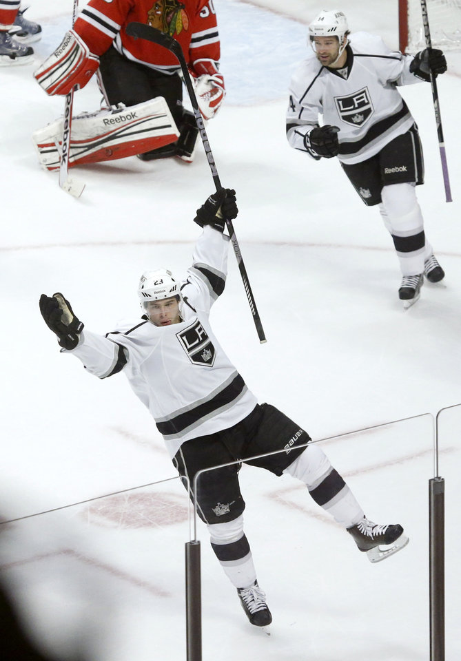 Los Angeles Kings right wing Dustin Brown, bottom, celebrates his winning goal as teammate Justin Williams watches during the third period of an NHL hockey game against the Chicago Blackhawks, Monday, March 25, 2013, in Chicago. The Kings won 5-4. (AP Photo/Charles Rex Arbogast)