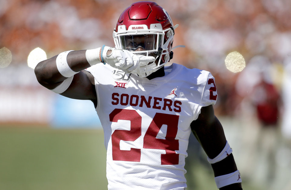 Photo - Oklahoma's Brian Asamoah (24) celebrates a tackle during the Red River Showdown college football game between the University of Oklahoma Sooners (OU) and the Texas Longhorns (UT) at Cotton Bowl Stadium in Dallas, Saturday, Oct. 12, 2019. OU won 34-27. [Sarah Phipps/The Oklahoman]
