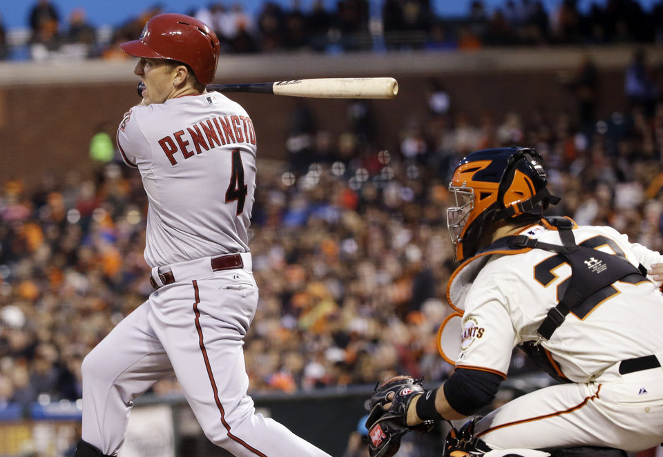 Photo - Arizona Diamondbacks' Cliff Pennington, left, drives in two runs with a bases-loaded single against the San Francisco Giants during the second inning of a baseball game on Thursday, April 10, 2014, in San Francisco. (AP Photo/Marcio Jose Sanchez)