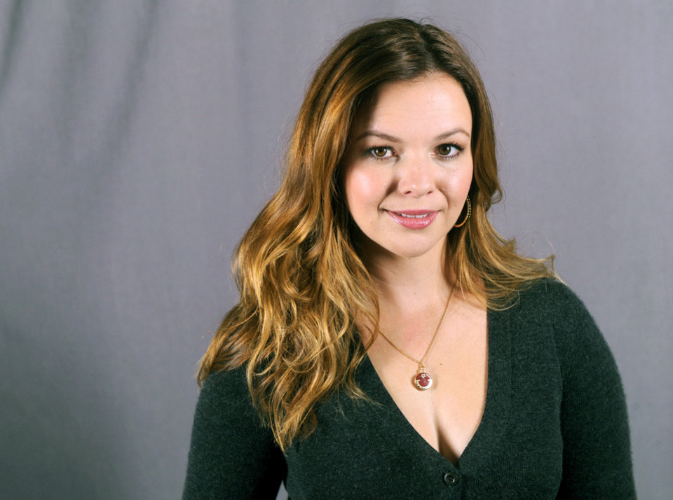 "This Sept. 18, 2013 photo shows actress Amber Tamblyn in New York. Tamblyn will guest star as Charlie Harper's daughter in the upcoming season of the comedy series ""Two and a Half Men,"" premiering Thursday, Sept 26 at 9:30 p.m. on CBS. (Photo by Diane Bondareff/Invision/AP)"