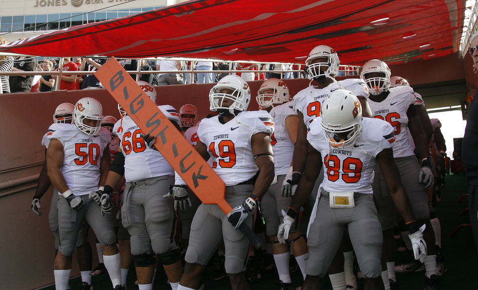Oklahoma State prepares to take the field during a college football game between Texas Tech University (TTU) and Oklahoma State University (OSU) at Jones AT&T Stadium in Lubbock, Texas, Saturday, Nov. 12, 2011. Photo by Sarah Phipps, The Oklahoman ORG XMIT: KOD