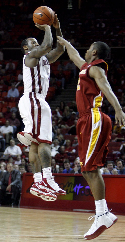 Photo - OU's Tommy Mason-Griffin (11) shoots as Iowa State's Chris Colvin defends during the college men's basketball game between the University of Oklahoma and Iowa State, Wednesday, Jan. 27, 2010, at the Lloyd Noble Center in Norman, Okla. Photo by Sarah Phipps, The Oklahoman.
