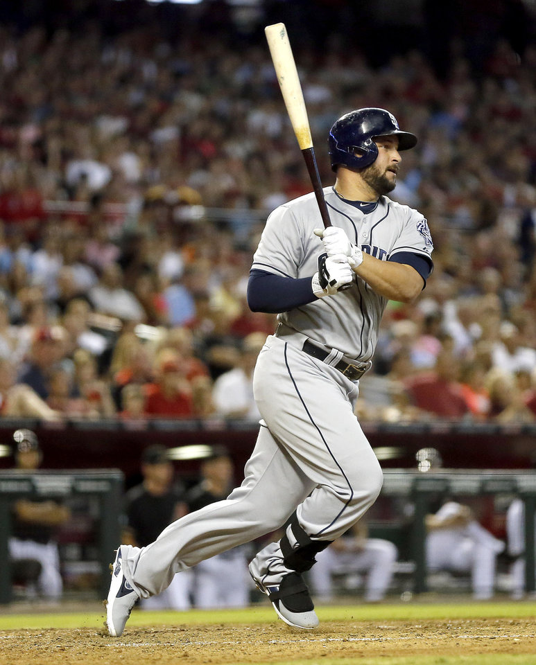 Photo - San Diego Padres' Yonder Alonso follows through on a three-run double during the third inning of a baseball game against the Arizona Diamondbacks, Saturday, July 27, 2013, in Phoenix. (AP Photo/Matt York)