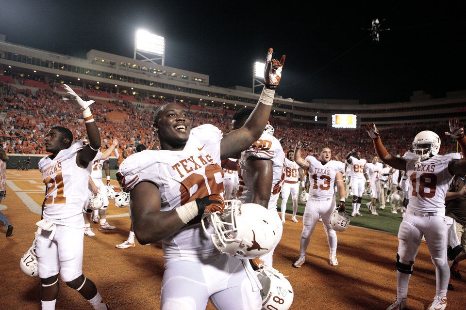 Texas' Chris Whaley (96) celebrates the Longhorns' win over Oklahoma State University (OSU) and the University of Texas (UT) at Boone Pickens Stadium in Stillwater, Okla., Saturday, Sept. 29, 2012. Texas on 41-36. Photo by Sarah Phipps, The Oklahoman