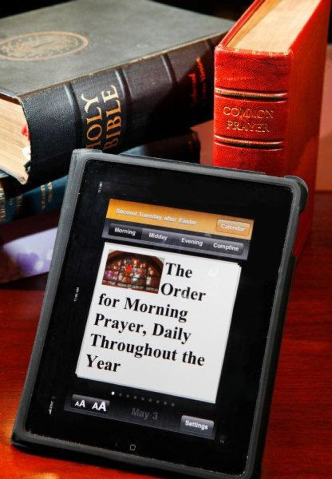 Photo - An iPad on the desk of the fRev. Patrick Bright, rector of All Souls Episcopal Church, features the iPhone app of the Book of Common Prayer, most commonly used by Anglicans, known as Episcopalians in the United States.  JIM BECKEL - THE OKLAHOMAN