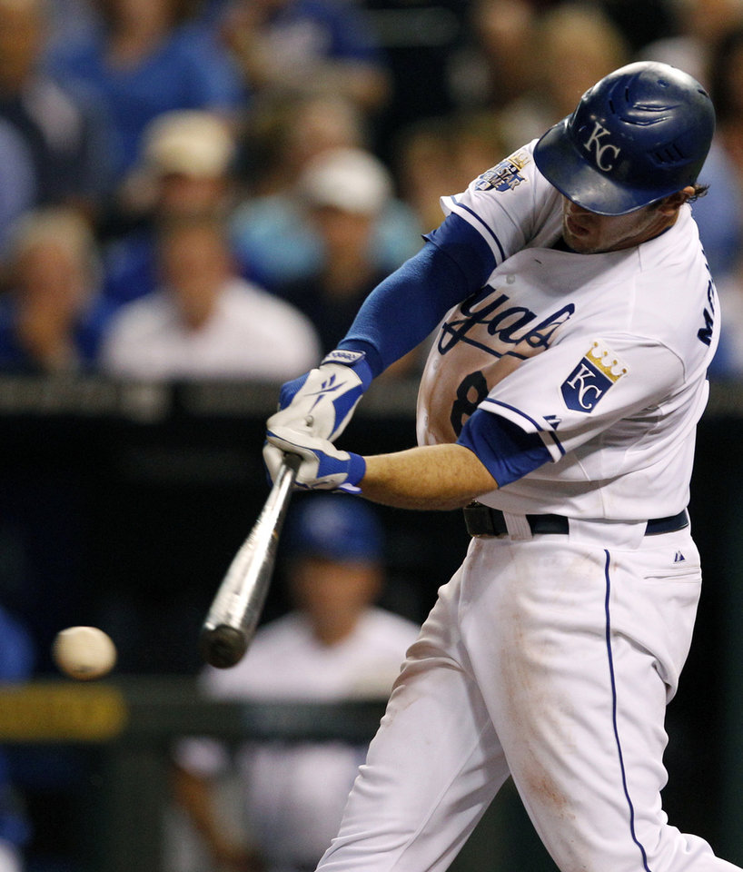 Photo -   Kansas City Royals' Mike Moustakas (8) hits a two-RBI single during the fifth inning of a baseball game against the New York Yankees in Kansas City, Mo., Thursday, May 3, 2012. (AP Photo/Orlin Wagner)