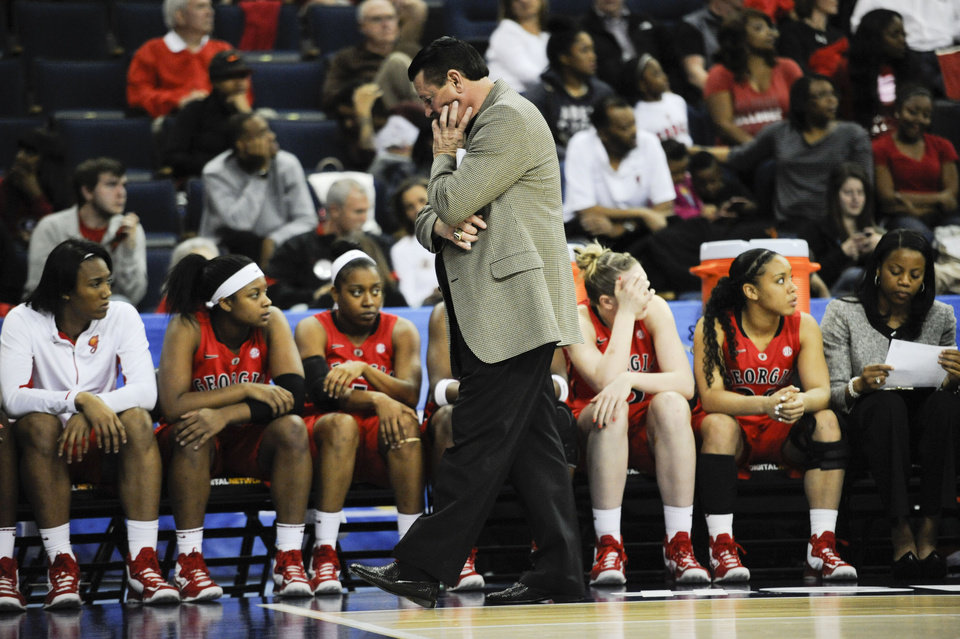 Photo - Georgia head coach Andy Landers walks the sideline with seconds on the clock against Kentucky during the second half of an NCAA college basketball game in the Southeastern Conference tournament on Saturday, March 9, 2013, in Duluth, Ga. Kentucky won 60-38. (AP Photo/John Amis)