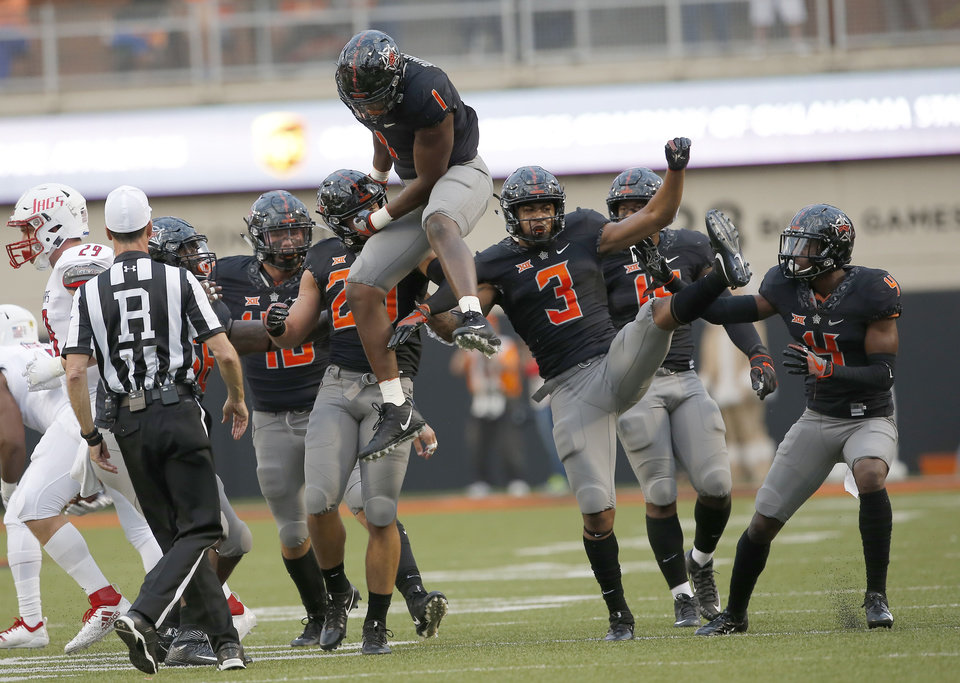 Photo - The Oklahoma State defense celebrate a play in the first quarter during a college football game between Oklahoma State (OSU) and South Alabama at Boone Pickens Stadium in Stillwater, Okla., Saturday, Sept. 8, 2018. Photo by Sarah Phipps, The Oklahoman