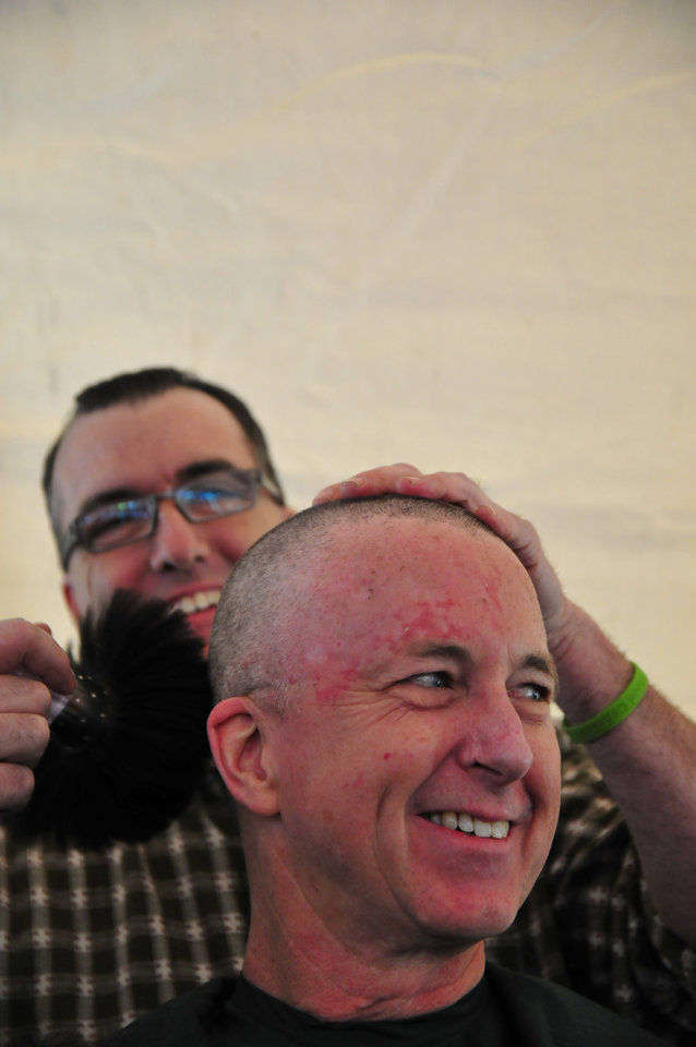 Steven Matthews, a member of Team Mayflower, reacts to his shaved head during the St. Baldrick's charity event at VZD's Restaurant and Club in Oklahoma City, Okla. Sunday, March 23, 2013.  Photo by Nick Oxford, for The Oklahoman