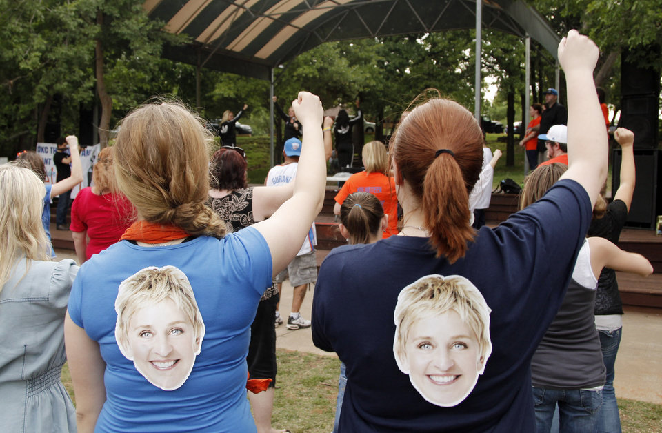 Photo - Girls with Ellen on their shirts learn the dance steps during a Thunder mob dance to send to Ellen DeGeneres at Hafer Park in Edmond Wednesday, May 18, 2011. Photo by Doug Hoke, The Oklahoman.