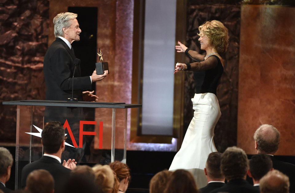 Photo - Michael Douglas, left, presents the AFI Lifetime Achievement Award to Jane Fonda at the 42nd AFI Lifetime Achievement Award Tribute Gala at the Dolby Theatre on Thursday, June 5, 2014, in Los Angeles. Looking on from left is Michael Douglas (Photo by John ShearerInvision/AP)