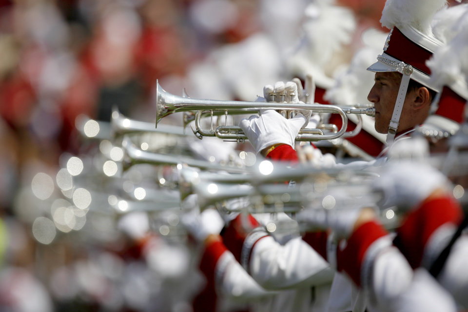 Photo - The OU band performs before the first half of the college football game between the University of Oklahoma Sooners (OU) and Florida State University Seminoles (FSU) at the Gaylord Family-Oklahoma Memorial Stadium on Saturday, Sept. 11, 2010, in Norman, Okla.   Photo by Bryan Terry, The Oklahoman
