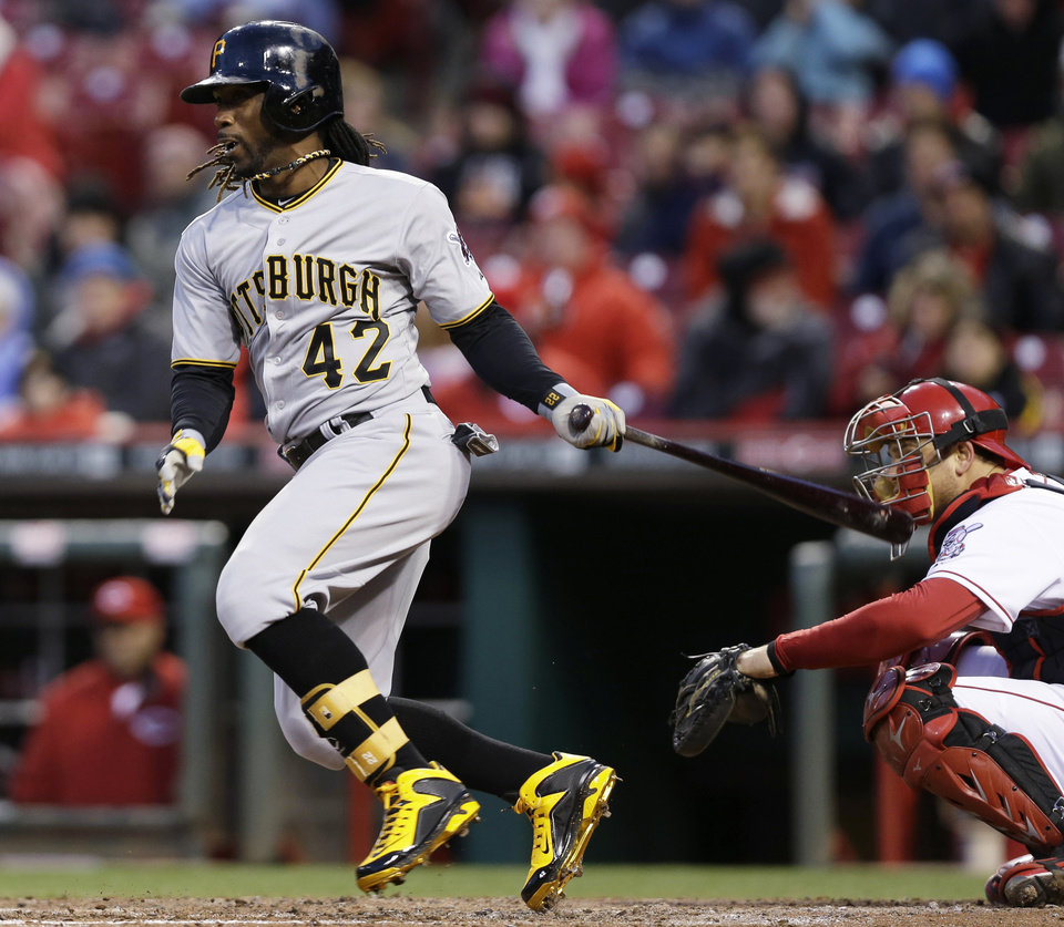 Photo - Pittsburgh Pirates' Andrew McCutchen watches his single off Cincinnati Reds starting pitcher Mike Leake in the fourth inning of a baseball game, Tuesday, April 15, 2014, in Cincinnati. (AP Photo/Al Behrman)