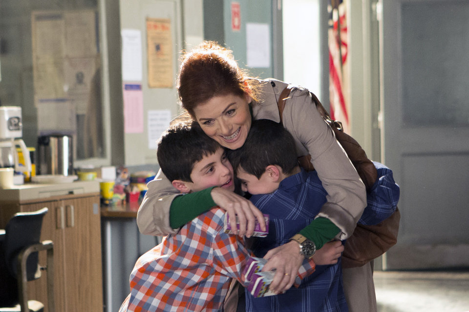Photo - In this photo provided by NBC, Debra Messing, top, portrays Laura Diamond in the new NBC series,