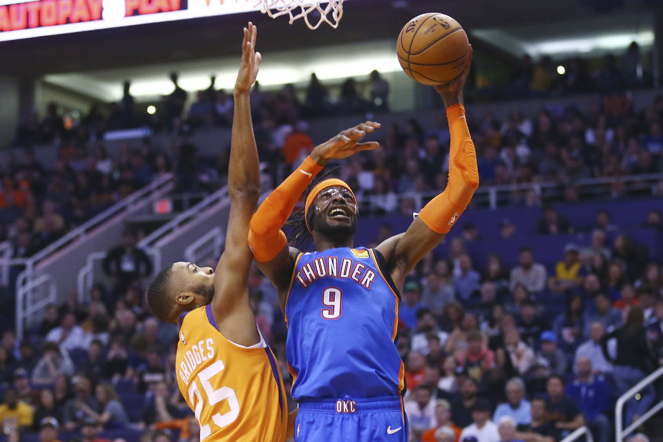 Photo - Oklahoma City Thunder center Nerlens Noel (9) shoots next to Phoenix Suns forward Mikal Bridges (25) during the first half of an NBA basketball game Friday, Jan. 31, 2020, in Phoenix. (AP Photo/Ross D. Franklin)