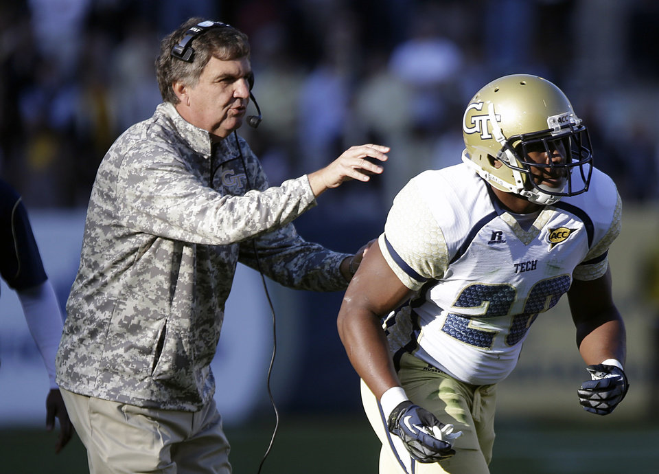 Georgia Tech head coach Paul Johnson, left, sends in David Sims in the first quarter of an NCAA college football game against Duke, Saturday, Nov. 17, 2012, in Atlanta. Georgia Tech won 42-24. (AP Photo/David Goldman)